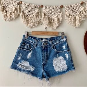 First of a Kind High Rise Distressed Levi's